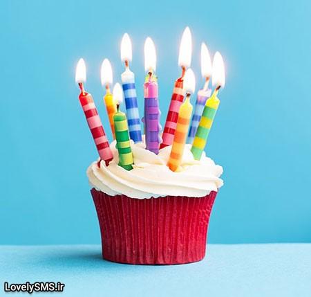 Birthday cupcake against a blu 71570377 اس ام اس های تبریک تولد ویژه اسفند ماه 96 و 2017